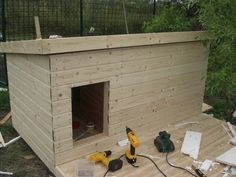 Insulated dog house - with a mini garden on top? Um, YES!