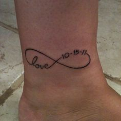 My new tattoo - it is the infinity symbol with our wedding date included. Love it!!