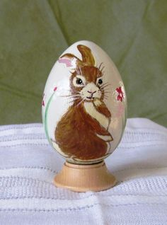 Bunny hand-drawn/painted on a wooden egg