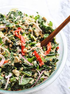 """This Greek-Inspired Kale Salad is loaded with Fresh Vegetables, Hearty Grains, and a Tofu """"Feta"""" to make it a satisfying and wholesome meal all on its own."""