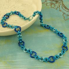 #chainmaille necklace https://www.etsy.com/listing/108060609/blue-skies-eye-candy-chainmaille