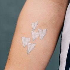 white paper airplanes: symbol for travel.. you never quite know where you will end up.