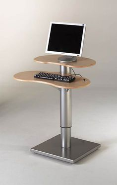 Free-standing OPAC station.  Very modern shape in birch wood and steel.