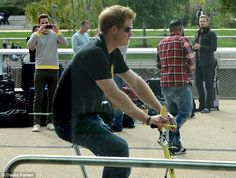 Wheels in motion: Prince Harry could be seen riding around on a bicycle ahead of the start of the Invictus Games