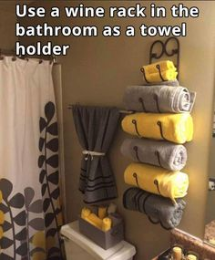 Bathroom towels with wine rack...it works and looks great! #MissionPinPossibleBzz