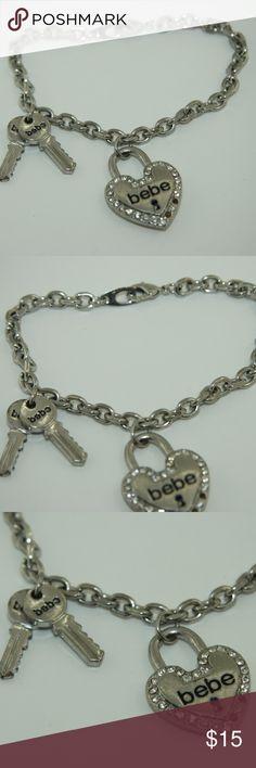 bebe bracelet bebe Bracelet.  Lock and Key Charms. Lock has rhinestones inset.  Silver tone.  Good condition. bebe Jewelry Bracelets