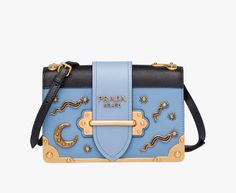 Prada Cahier calf leather bag with metal details Detachable leather shoulder strap Bronze hardware Bronze lettering logo Flap closure with snaps One inside pocket Nappa leather lining