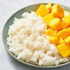 Mango Sticky Rice - Delish.com Tostadas, Cilantro, Sticky Rice Recipes, Dorm Food, Mango Sticky Rice, Strawberry Rhubarb Crisp, Antipasto Platter, Thai Dessert, Toasted Sesame Seeds