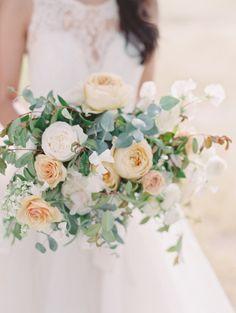 Garden roses, ranunculus and eucalyptus: http://www.stylemepretty.com/2015/06/10/romantic-ethereal-wedding-inspiration/ | Photography: Carmen Santorelli - http://carmensantorellistudio.com/