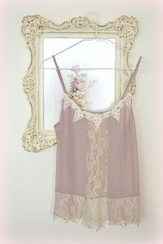 This listing is for one lovely vintage pale mauve camisole. Silky fabric - nylon in pale mauve with cream coloured lace. Size Medium. Tag says Pins