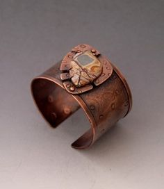 Handmade wide copper cuff bracelet with a turtle set Sonoran dendritic Rhyolite cabochon. Rolled milled and stamped texture on the cuff band,dark patina to enhance design.