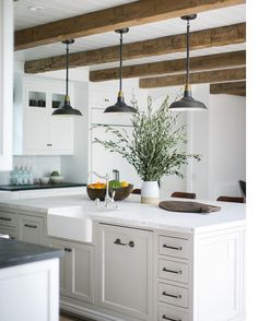 Gorgeous white kitchen with rustic beams