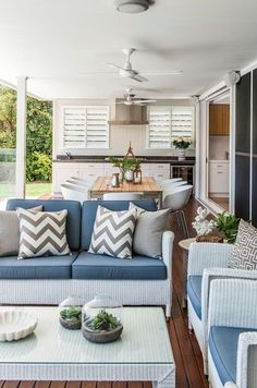 don't need outdoor kitchen. a similar sized alfresco. good layout. roller blinds for wet weather?