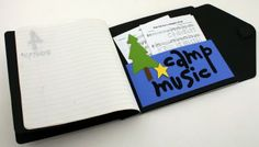 camp music holder in back of notebook <3