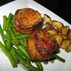 Bacon Wrapped Pork Medallions.  This is a favorite in my family.  Made it for E and as he was eating kept saying how delicious it was.  Served with green beans, wild rice and salad.