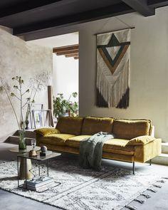 Living room with yellow velvet sofa