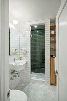 Upper East Side bathroom renovation with mixture of tiles and marble floors: stylish , low maintenance & practical.