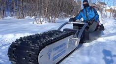 I WANT!!!   From Canadian, a tread-based sled called MTT-136. See video. Electric snow sled [mcg]