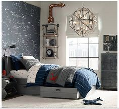 Like the accent wall, but don't want a space theme. Love the shelves and metal dresser, pendant, too. Nice color mix.