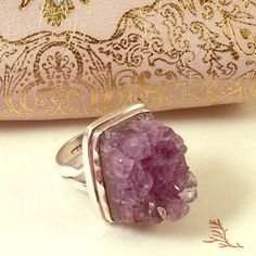 """Silver & Amethyst Ring Sz 7 Silver & Amethyst Ring Sz 7. Sterling silver setting and stamped inside with 92.5. Never worn. Ring is about 1"""" long and 1/2"""" wide, 1/2"""" high. Jewelry Rings"""
