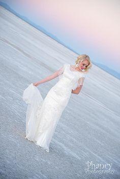Sunset bridals at the Utah Salt Flats. A touch of vintage for this fabulous bride. #utah #utahwedding #wedding #saltflats #weddingphotography #bridal #vintage #sunset #utahphotographer #phancyphotography
