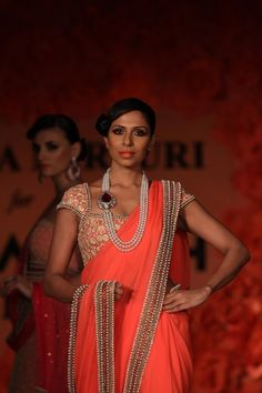Bridal orange and gold saree and blouse. Love the statement necklace.