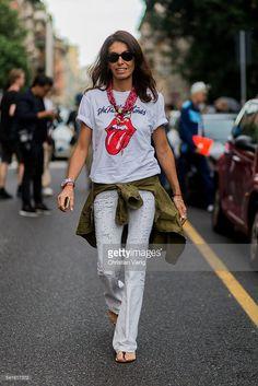 Viviana Volpicella outside Prada during the Milan Men's Fashion Week Spring/Summer 2017 on June 19, 2016 in Milan, Italy.