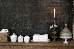chalkboard wall.. I love that idea for a kids room.. they can color on the walls all they want!