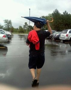 Anyone that uses an umbrella like this: | 35 Ridiculously Dumb People That Will Make You Feel Like A Genius