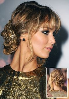 If ever we were to picture a hairstyle most appropriate for a Hunger Games premiere, this is it. The serpentined gold chain throughout J.Law's loosely braided chignon channeled the Grecian setting...