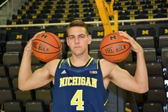 """UM soph Mitch McGary has received a one-year suspension after failing a drug test for marijuana. """"I don't think the penalty fits the crime,"""" he says. """"One year is overdoing it a little bit. Michigan Athletics, Michigan Wolverines, Nba Draft, Let's Get Married, Drug Test, Go Blue, Thunder, Basketball, Crime"""