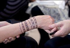 several bracelet wrist tattoos - notice the white diamonds  2069ac0cd9f