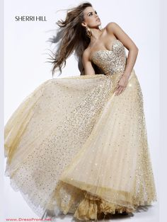Striking royalty sequined long prom gown Sherri Hill 2585. You will be the most deserving girl to steal the crown from the rest of the crowd making presence with this striking gown. This design features a strapless sweetheart neckline with a fitted all over beaded bodice. From the natural waist layers of a full floor length skirt sparkles all over the place and is  covered by a tulle overlay. Add jewels and heels to look great. Available in Gold, Pink and Blue.