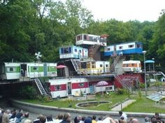 Has this photo reached your in-box yet? It's been tagged as 'Redneck Mansion.' Actually it's neither of those things. It's really an outdoor theater set that was used by the Theater het Amsterdam Bos for the Anton Chekhov play Ivanov back in '05, as the picture below demonstrates. Second image via Snopes.