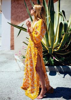 cool Yellow maxi dress. so pretty yet sexy!! i love how it shows leg and the…