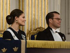 20 December 2016 - Swedish royals at the formal gathering of the Swedish Academy - coat by Filippa K, dress by H&M, clutch by Alexander McQueen