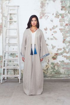 """Crystal earrings and braided necklace with Swarovski crystals both by Jolita Jewellery for Aywa """"Linen Room"""" abayas collection."""