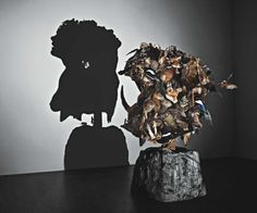 tim noble and sue webster use random scraps to make recognisable images through the use of projected shadows. genius