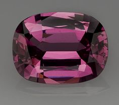 Gem Rose Spinel Burma This oval-shaped gem spinel is characterized by a distinctive rich rose color. Both its clarity and luster are excellent. This is an excellent choice either for the serious collector or for the designing jeweler. Such fine Burmese material is exceedingly rare in today\'s market. Weighing approximately 8.29 carats and measuring 14.0 x 11.0 x 6.0mm