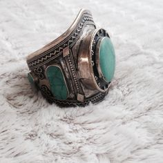 boho stoned cuff Worn only once. Great Condition. The worn or vintage look is the style of this cuff to give off that hippie/bohemian vibe. Not sure whether the turquoise stones are real but they do look like the real ones. No Holds. No Trade. Price is Firm. Vanessa Mooney Jewelry Bracelets