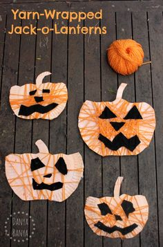 Kids craft: Yarn-wrapped paper plate Jack-o-Lanterns for Halloween.