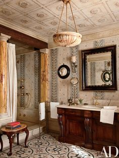 The master bath is clad in ancient-Roman-style mosaic tile; the marble-top walnut vanity was custom made by Studio Peregalli | archdigest.com