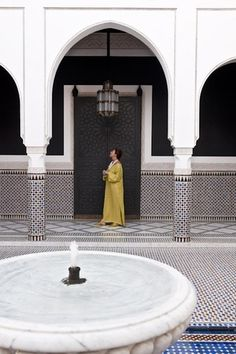 Woman in the courtyard of restaurant Le Marocain of Hotel La Mamounia in Marrakech