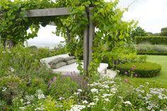 divine day bed under a vine covered pergola