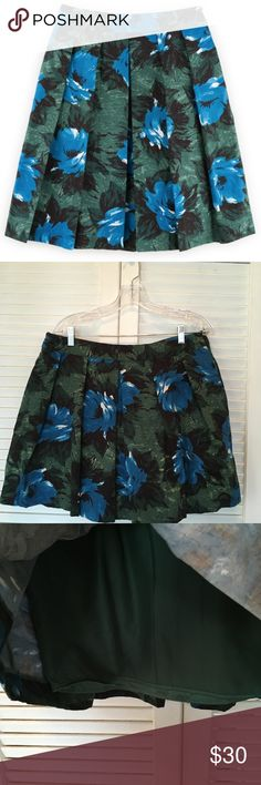 Boden Sophia Skirt Blue and Green Floral Beautiful blue and green print Boden skirt. Blooming with bold art house florals. Has a full skirt, 50s shape. Fully lined. Size zip. Outer is 100% cotton, lining is 100% polyester. Women's Sz 12  Very Gently Worn Boden Skirts