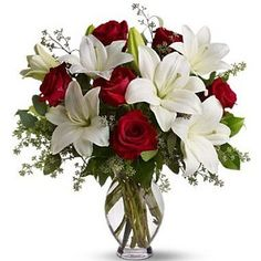 Beautiful red roses and white lilies floral arrangement- What Brice sends her toward the beginning of the book