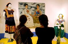 Visitors look at the painting 'Las dos Fridas' by Frida Kahlo during a visit to the Blue House, now the Frida Kahlo Museum