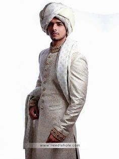 Traditional #wedding #sherwani in pearl color, embellished collar, front and sleeves  http://www.needlehole.com/offwhite-reception-sherwani-for-men-in-jamawar-fabric.html #Hsy offwhite #reception sherwani and #0men's sherwani uk. Latest pakistani mens sherwani, reception sherwani suits collection with kurta shalwar by hsy stores in usa, uk