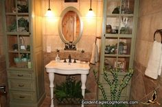 This is a great example of a modern bathroom with tile from floor to ceiling. Featuring full height vanity cabinets with glass doors and authentic raised panel sides with an antique sage finish. Also, an all white dual legged pedestal sink.