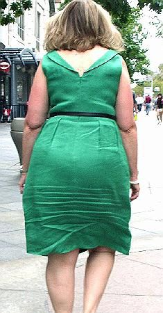 A unique high-waist linen dress, her wrinkles crushed into the back highlighted by her pear shape. Makes her dress look very sexy!